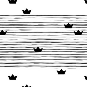 Floating on water little paper boats and abstract water waves stripes monochrome black and white