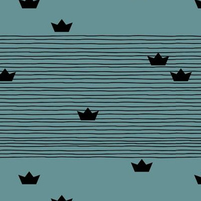 Floating on water little paper boats and abstract water waves stripes monochrome black and blue winter