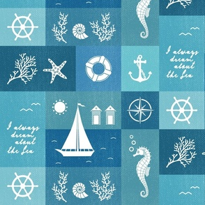 Vintage board of nautical white items on blue fabric