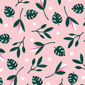 Lush summer jungle tropical rainforest leaves and birds of paradise flowers green pink