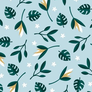 Lush summer jungle tropical rainforest leaves and birds of paradise flowers teal blue ochre blue green