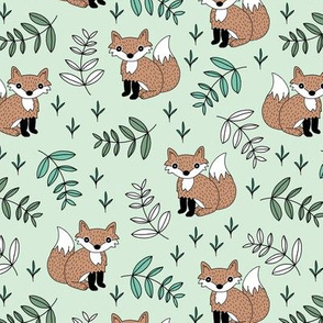 Little fox woodland summer forest and lush green leaves baby nursery design mint boys