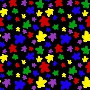 Colorful meeple toss on black