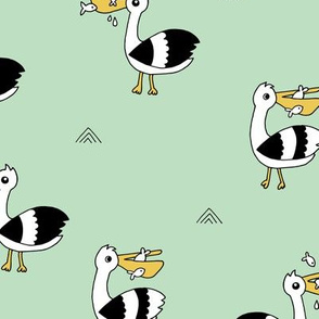 Little Pelican and fish friends of the sea summer birds black and white mint