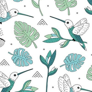 Little hummingbirds and birds of paradise tropical rainforest leaves summer blue mint green
