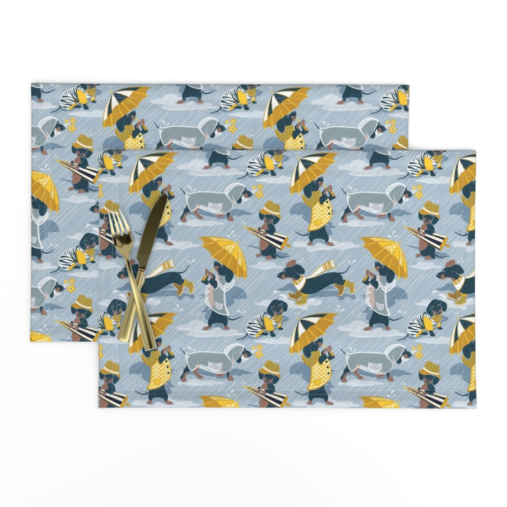Lamona Cloth Placemats featuring Small scale // Ready For a Rainy Walk // pastel blue background navy blue dachshunds dogs with yellow and transparent rain coats and umbrellas  by selmacardoso