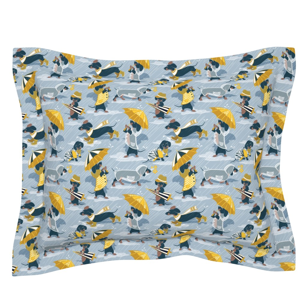 Sebright Pillow Sham featuring Ready For a Rainy Walk // small scale // pastel blue background navy blue dachshunds dogs with yellow and transparent rain coats and umbrellas  by selmacardoso