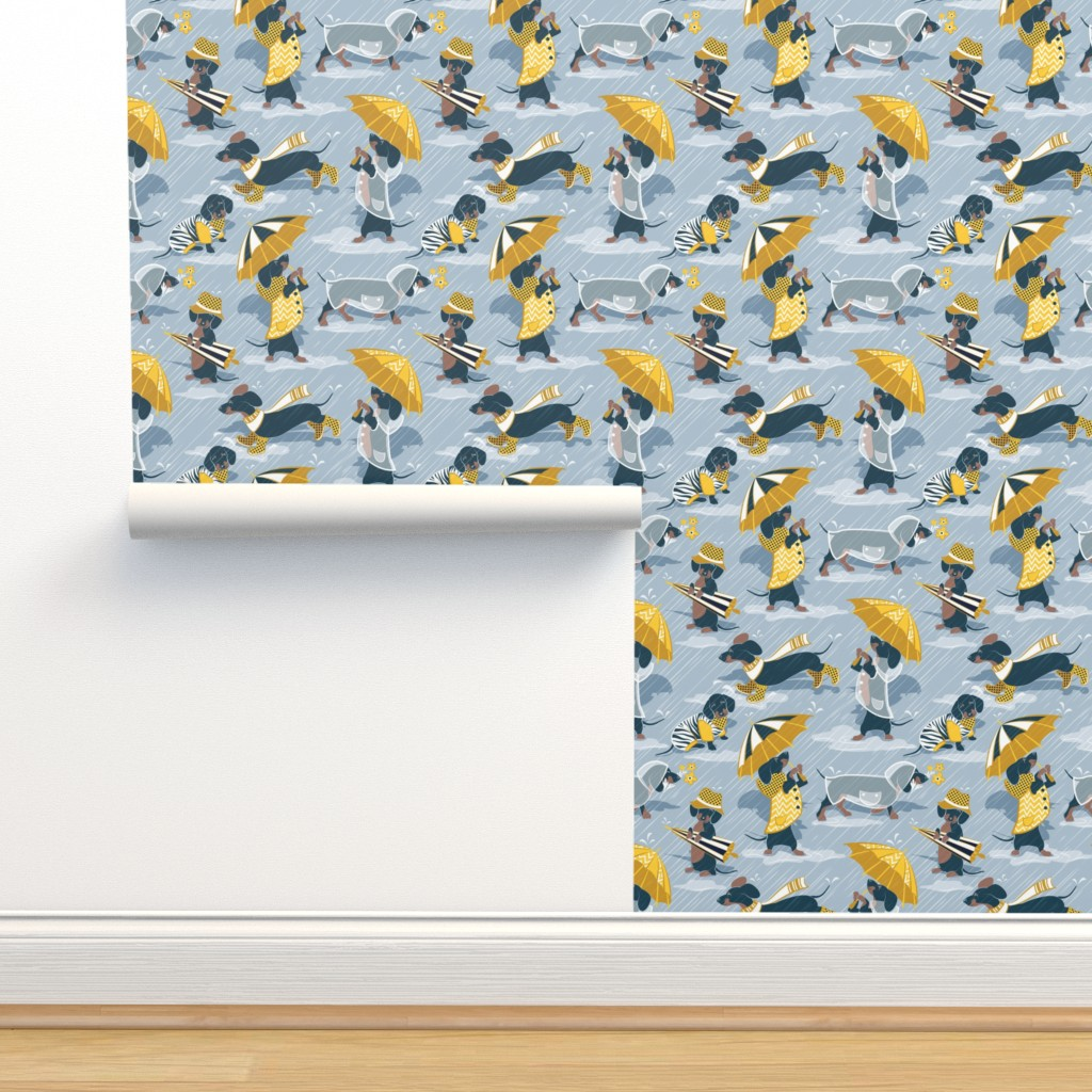 Isobar Durable Wallpaper featuring Ready For a Rainy Walk // small scale // pastel blue background navy blue dachshunds dogs with yellow and transparent rain coats and umbrellas  by selmacardoso