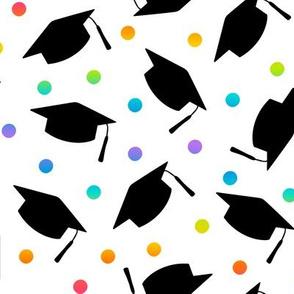 Tossed Graduation Caps in Black with Rainbow Confetti