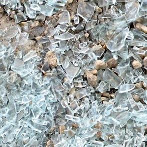 Broken Glass on Pebbles