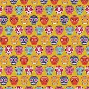 Colorful Sugar Skulls on Yellow Background