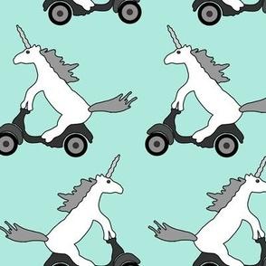 unicorns on moped on teal