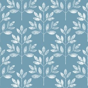 White leaves pattern on blue