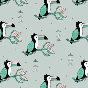 Sweet little toucan branch leaves and birds jungle green