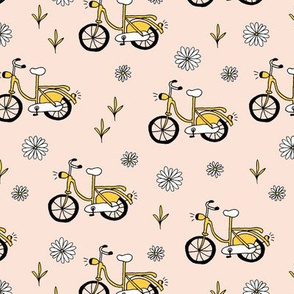 Little bikes and daisies summer day cycling ochre yellow girls