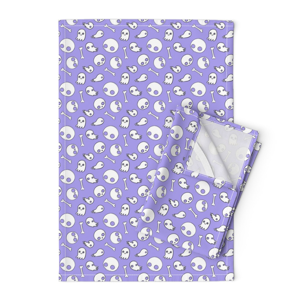 Orpington Tea Towels featuring Cute Skulls and Ghosts Lavender by planet_kimberly