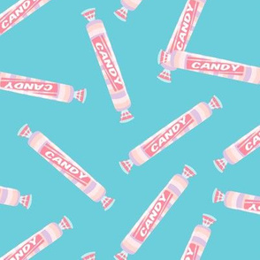 candy rolls -  tablet candy - pastel pink toss on blue - LAD19
