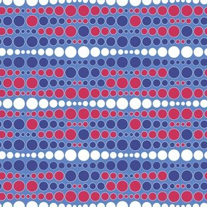 Colorful uneven bars of dots red blue