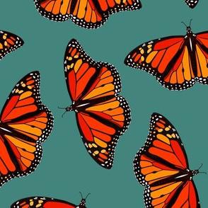 Monarch Butterflies pattern on teal - large