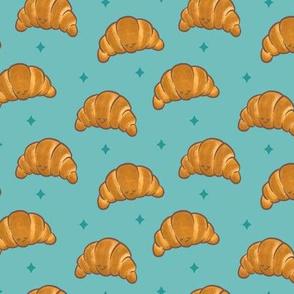 Sleepy Kawaii Croissants on Blue