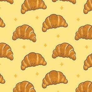 Happy Sleepy Kawaii Croissants on Yellow