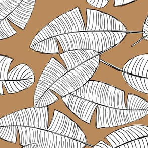 Lush leaves palm tree leaf garden tropical summer vibes and surf beach dreams caramel brown