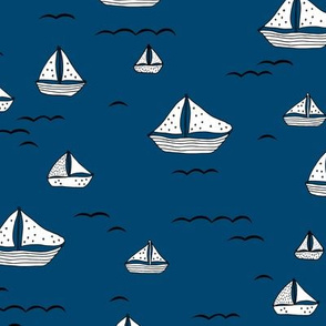 Summer sea little sailing boat and tiny ships and waves on water navy blue white