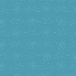 Blue ocean waves and sand dollars