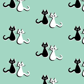 Mcm cats with moustaches on  pale mint - small