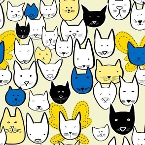 Cat Faces on light yellow