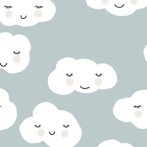Sweet puffy clouds kawaii sky smiling sleepy cloud in cool dusty blue winter