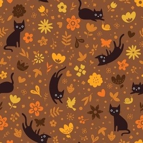 Cats frolicking in the garden - autumn - small scale