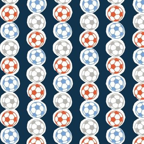 Soccer balls in red, blue & silver