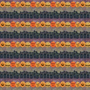black kitty cats and carved pumpkins