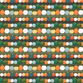 heirloom pumpkins on green stripe