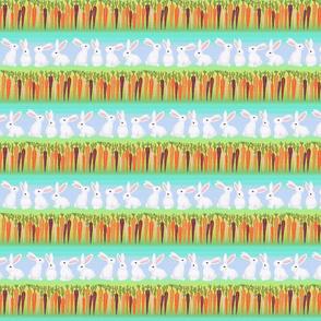 white bunny rabbits rainbow carrots on blue stripes
