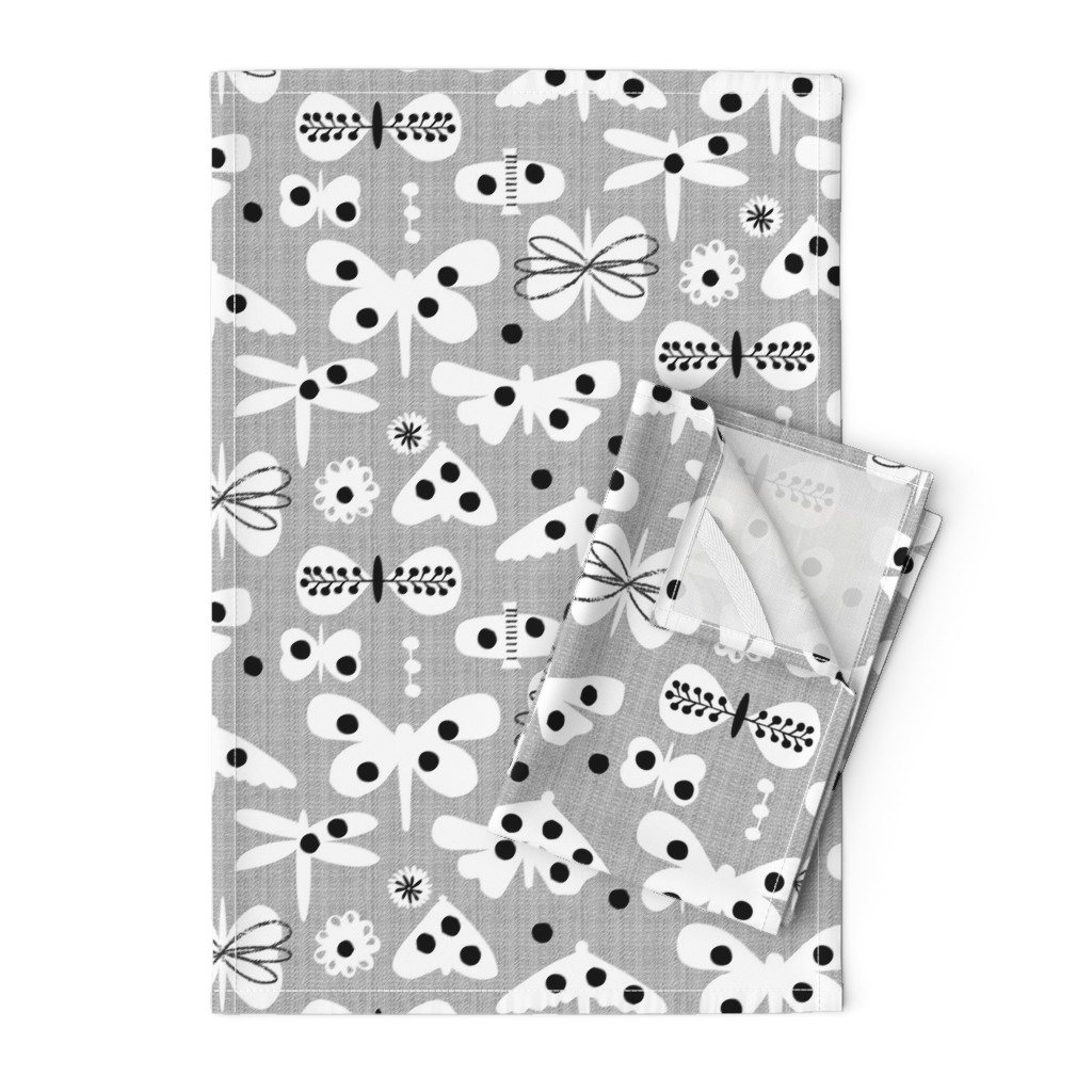Orpington Tea Towels featuring Black and white and polka dot moths by ottomanbrim