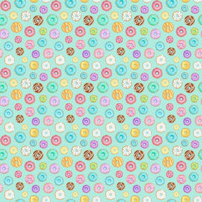 Scattered Rainbow Donuts on mint spotty - small scale