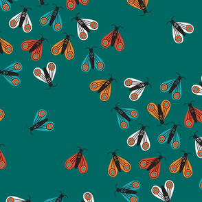Colorful folk moths invasion on teal Fabric
