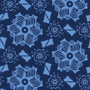 Indigo blue abstract mosaic flower tiles.