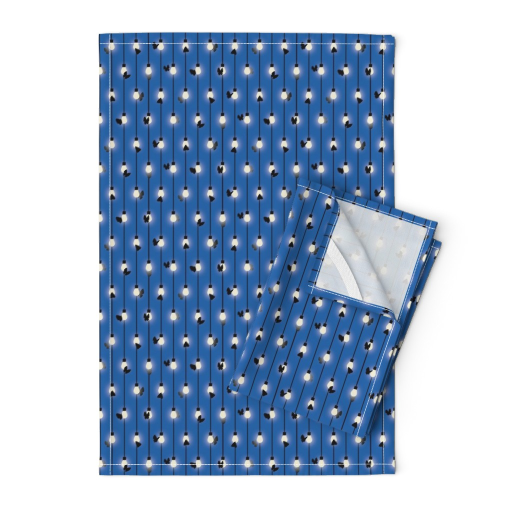 Orpington Tea Towels featuring Moths on Fairy Lights by autumn_musick