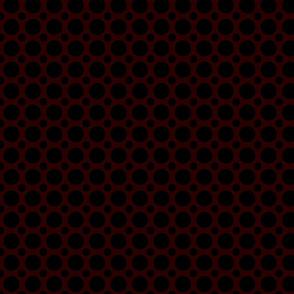 black polka dots on brick