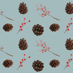 Pine cones red berries on verdigris gray