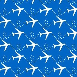 Airplanes in the sky:  white planes on cobalt blue background