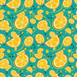 Oranges and Orange Slice on a Teal Background