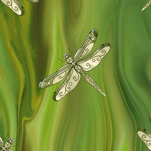 dragonfly on green glass