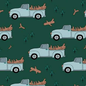 Pick up truck driving logs timber lumber jack design green forest night