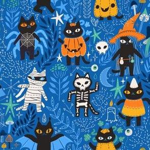 Spooky happy Halloween black cats.