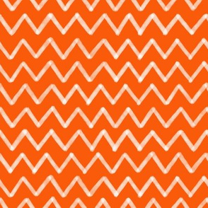 white zig zag orange background