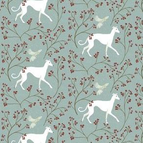 Greyhound in a winter forest
